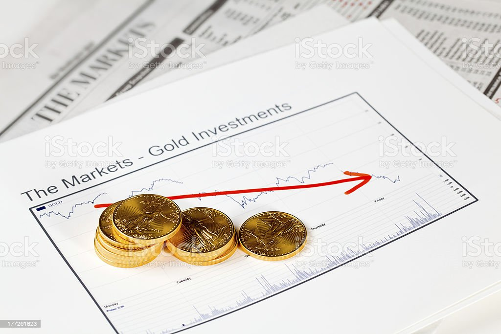 Golden Eagle coins on newspaper royalty-free stock photo