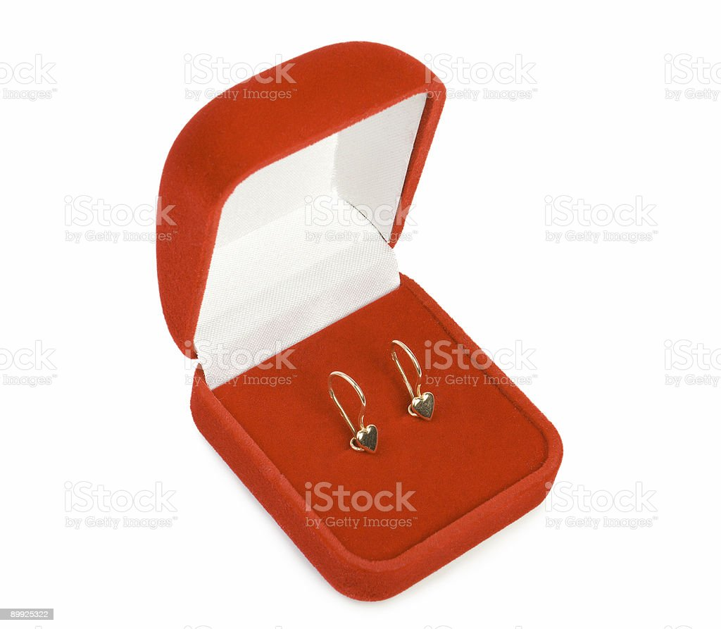 Golden earrings in red box. royalty-free stock photo