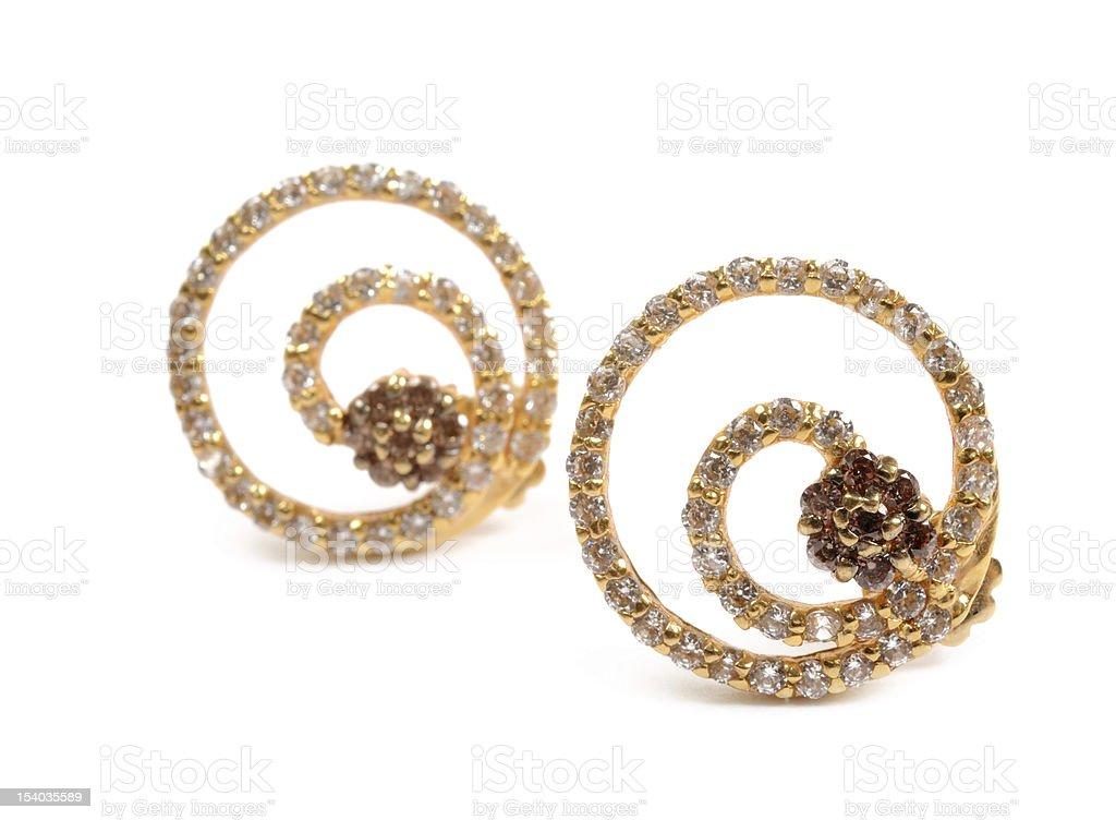 Golden earrings stock photo