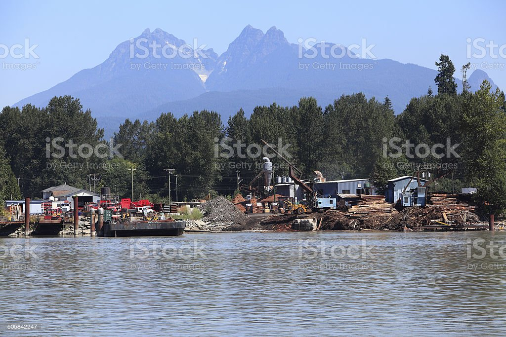 Golden Ears Mountain Range With Fraser River Sawmill stock photo