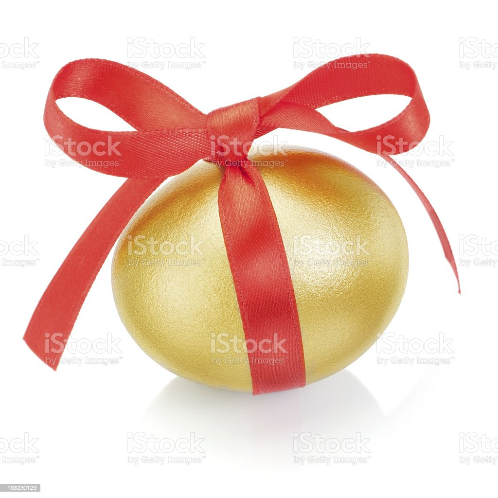Golden easter egg with red bow. On a white background. royalty-free stock photo