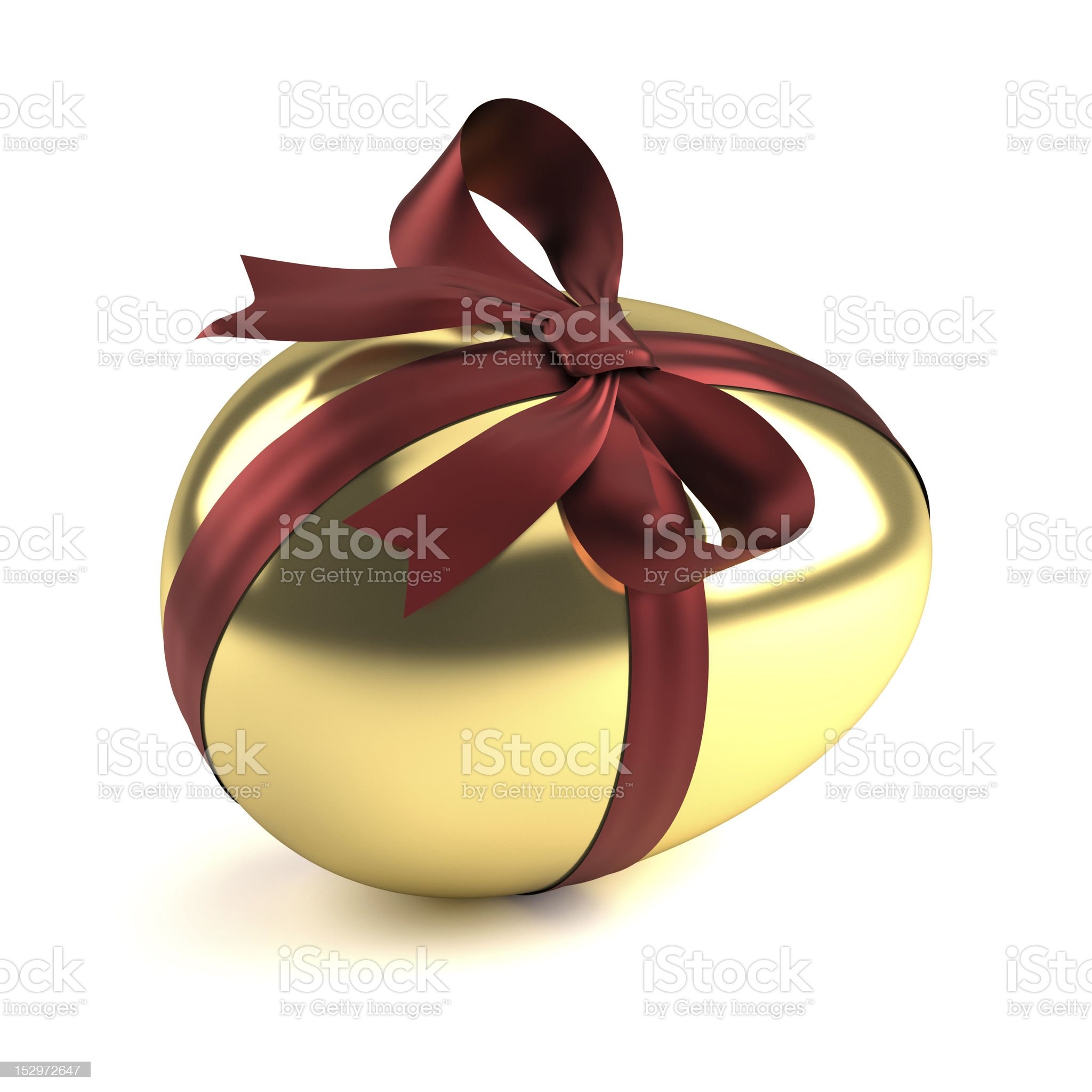 golden easter egg with red ribbon royalty-free stock photo