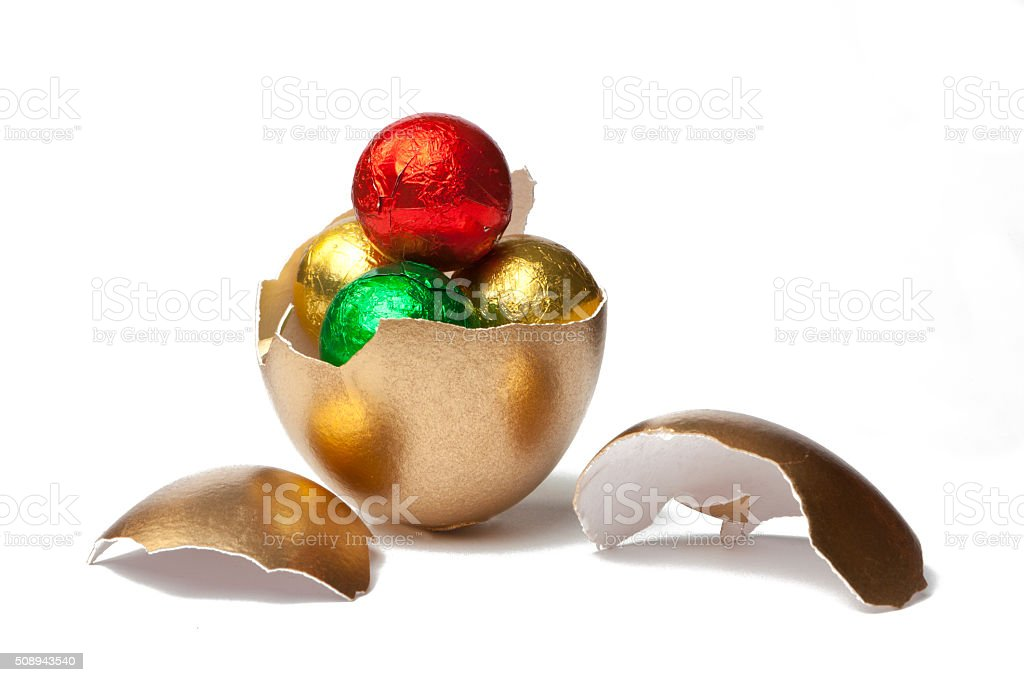 Golden Egg with Chocolates stock photo