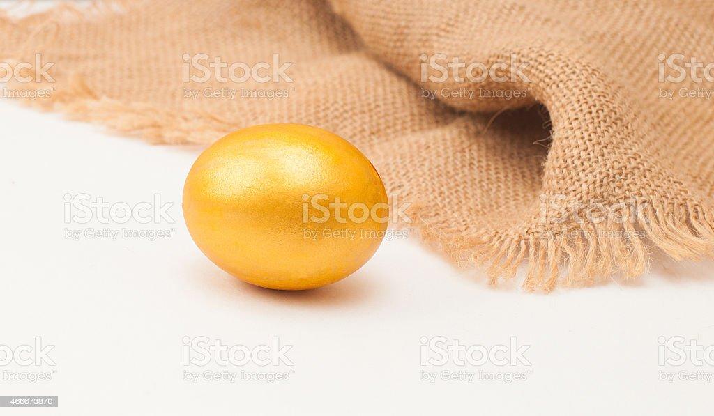 golden egg with sacking on white background stock photo