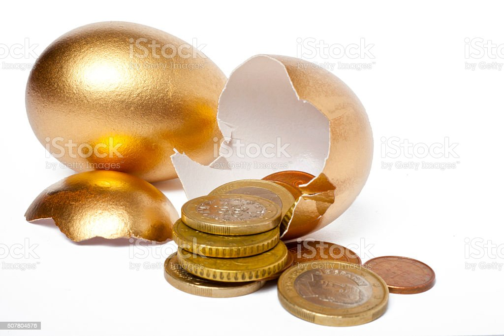 Golden Eggs With Euro Coins stock photo