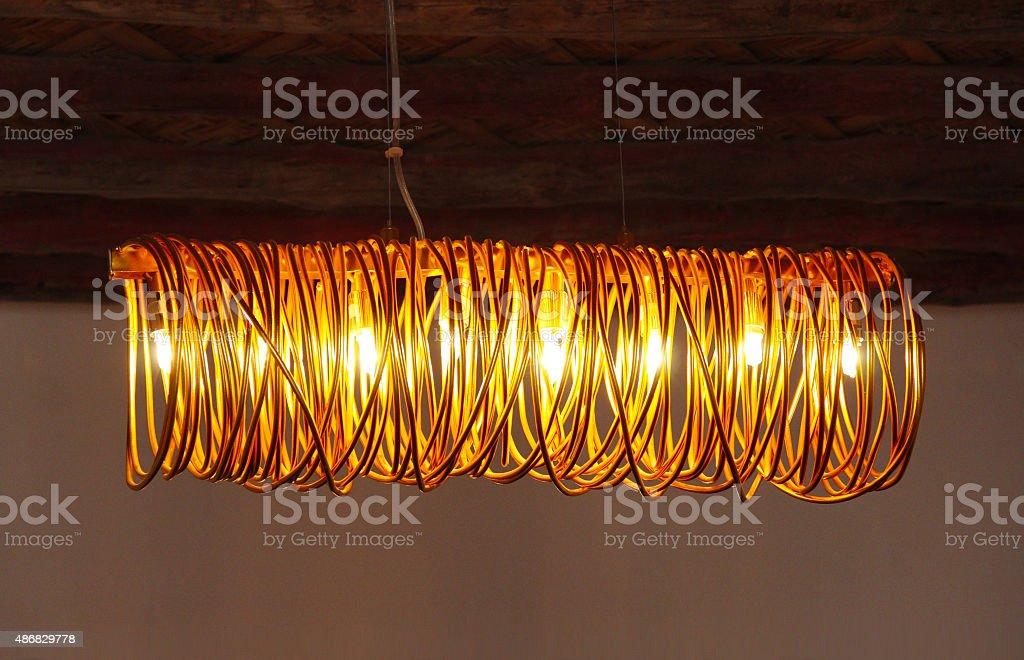 Golden elegant coiling lamp stock photo