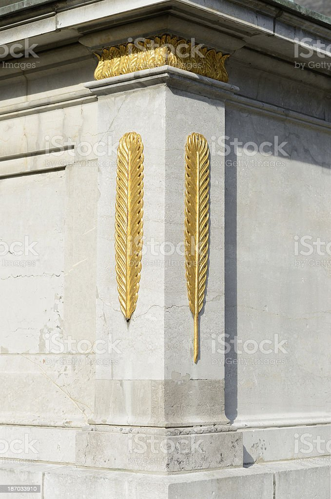 Golden feathers made of stone royalty-free stock photo