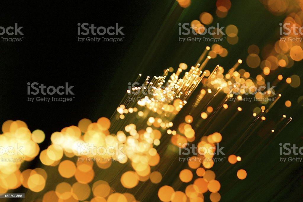 golden (yellow) fiber optic cables stock photo