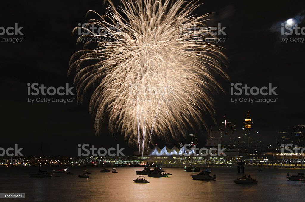 Golden Fireworks Vancouver Harbor with Skyline and Moon royalty-free stock photo
