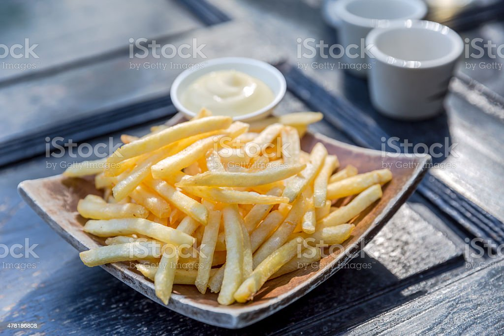 Golden French fries potatoes ready to be eaten stock photo
