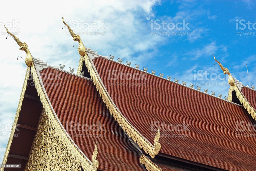 golden gable apex on jediluang temple roof stock photo