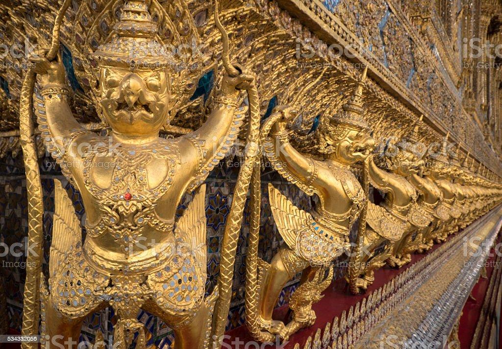 Golden Gargoyles, Royal Palace, Bangkok stock photo