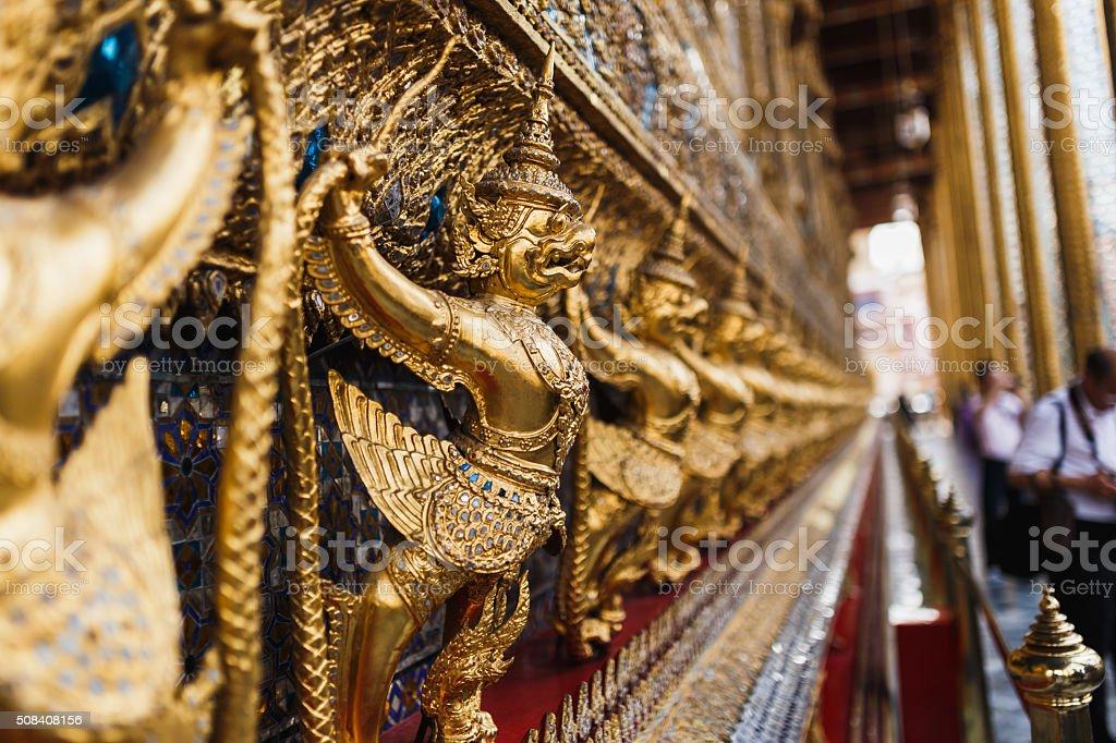 Golden Garuda statues surrounding Wat Phra Kaew temple stock photo