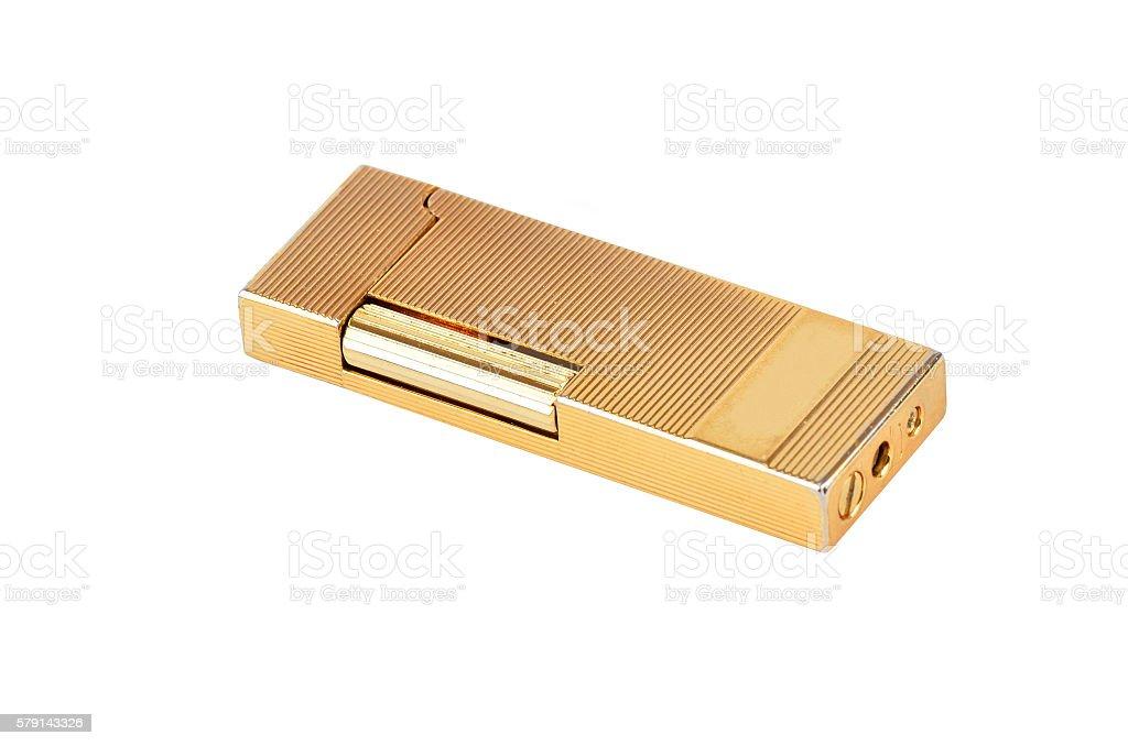 Golden gas cigarette lighter stock photo