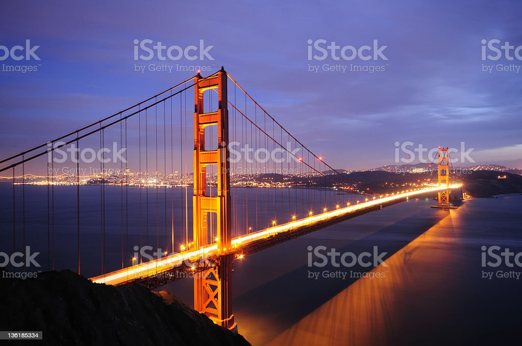 Golden Gate and Bay Bridges glow in the dusk royalty-free stock photo