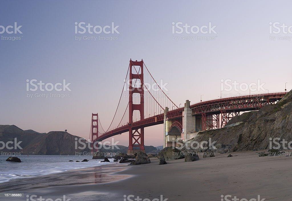 Golden Gate Bridge after sunset viewed from Baker Beach royalty-free stock photo