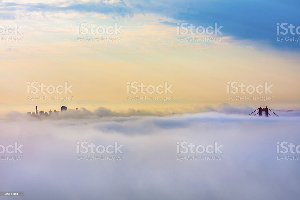 Golden Gate Bridge and San Francisco above Clouds after sunrise royalty-free stock photo