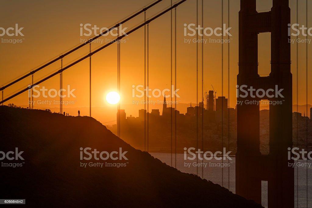 Golden Gate Bridge and San Francisco Downtown at Sunrise stock photo
