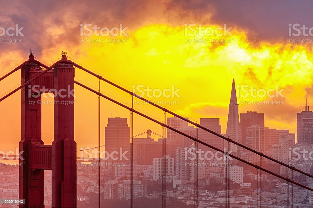 Golden Gate Bridge and San Francisco Downtown Skyline at Sunrise stock photo