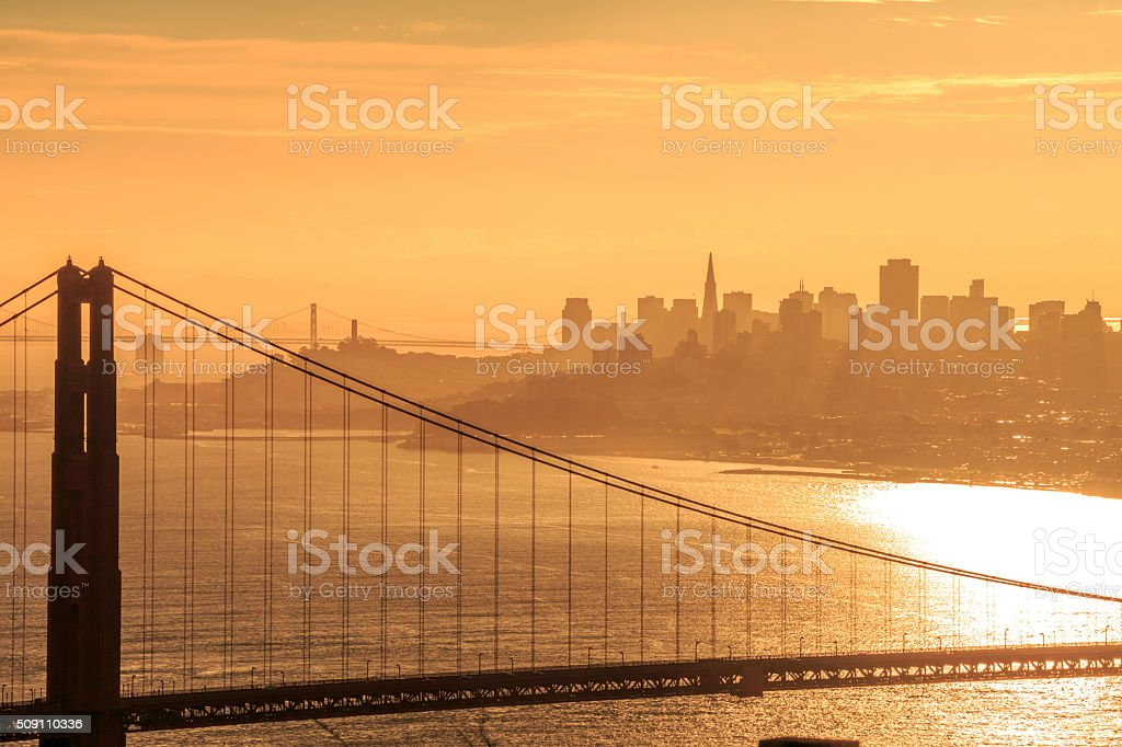 Golden Gate Bridge and San Francisco Skyline at Sunrise stock photo
