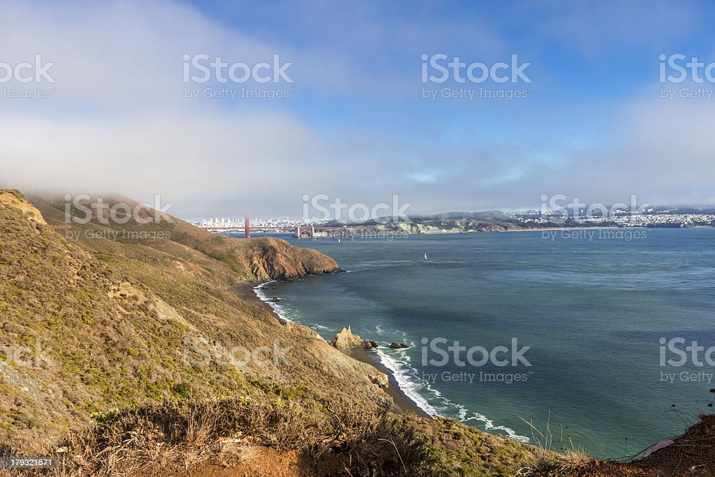 Golden Gate Bridge and San Francisco throught the fog royalty-free stock photo