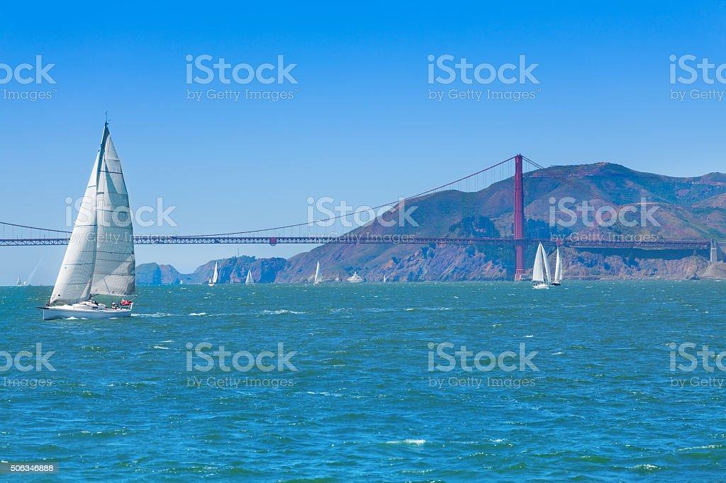 Golden gate bridge and yachts stock photo