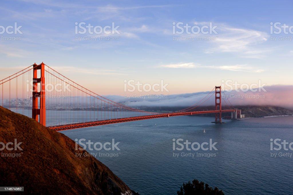 Golden Gate Bridge at sunset with fog royalty-free stock photo