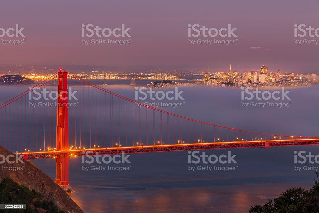 Golden Gate Bridge at twilight with low fog stock photo