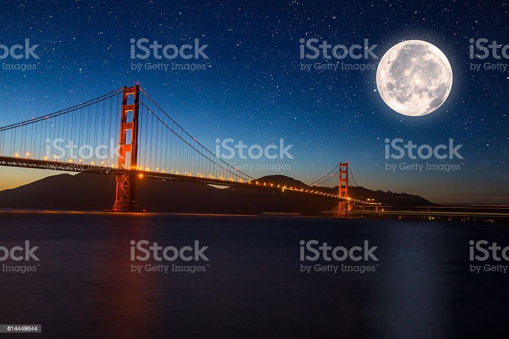 Golden Gate Bridge in San Francisco CA night full moon stock photo