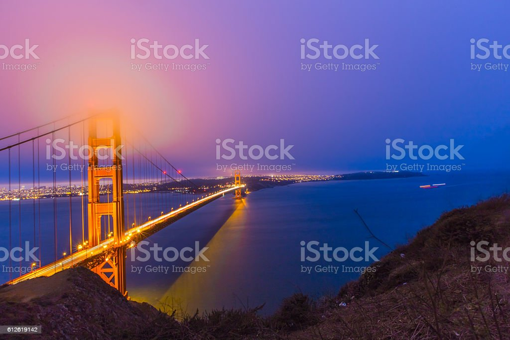 Golden Gate Bridge in San Francisco in a foggy night stock photo