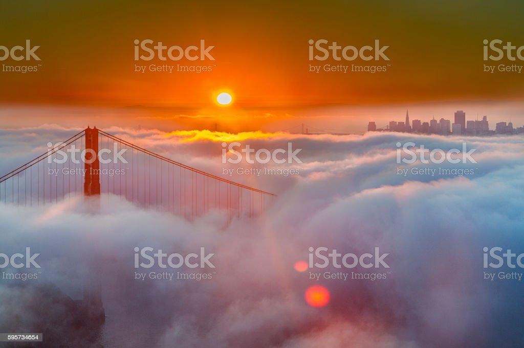 Golden Gate Bridge Low Fog at sunrise stock photo