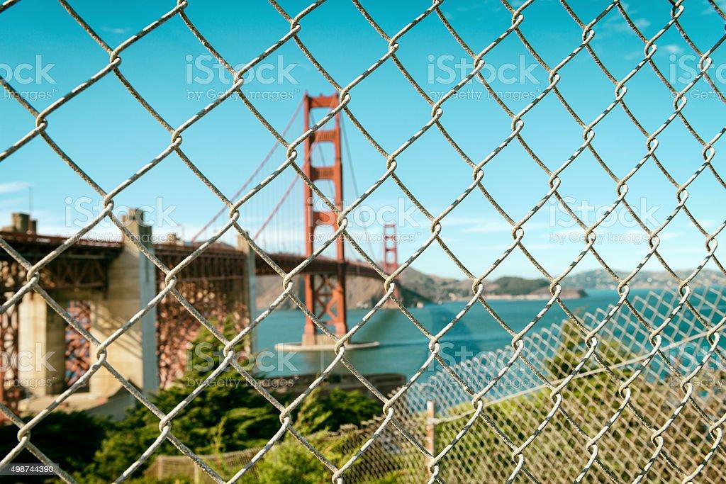 Golden Gate Bridge through wire fence stock photo