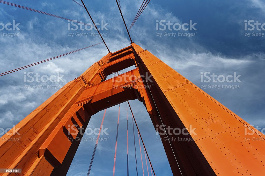 Golden Gate Bridge Tower Rises into Blue Sky royalty-free stock photo