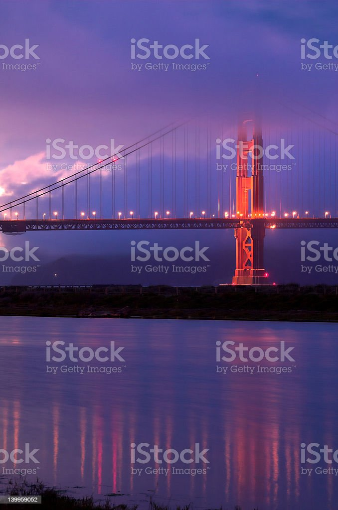 Golden Gate Bridge under fog at dusk royalty-free stock photo