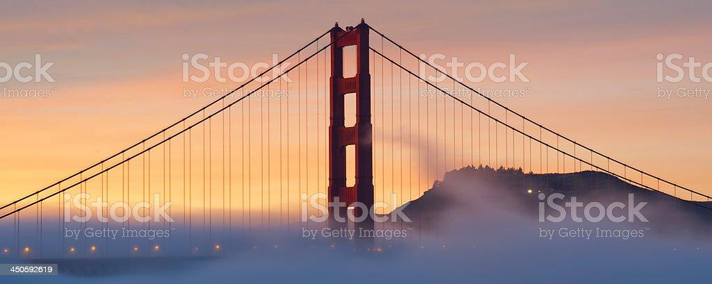 Golden Gate Bridge with fog at sunset royalty-free stock photo
