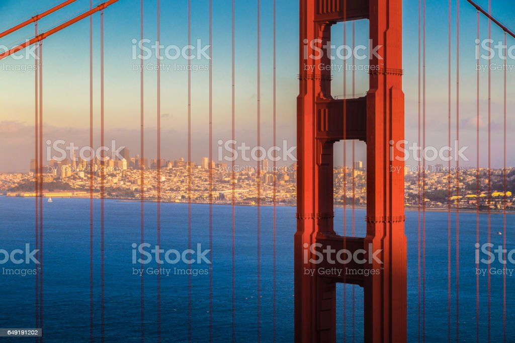 Golden Gate Bridge with San Francisco skyline at sunset, California, USA stock photo