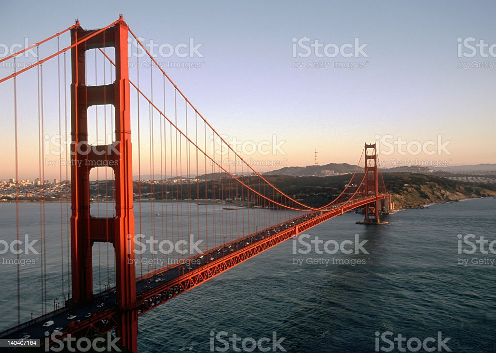 Golden Gate Bridge with water flowing below at sunset royalty-free stock photo