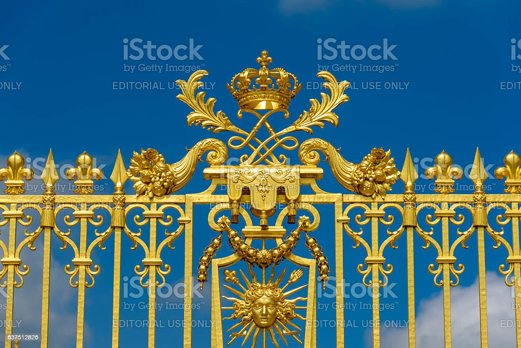 Golden gate entrance of Versailles palace in sunny day stock photo