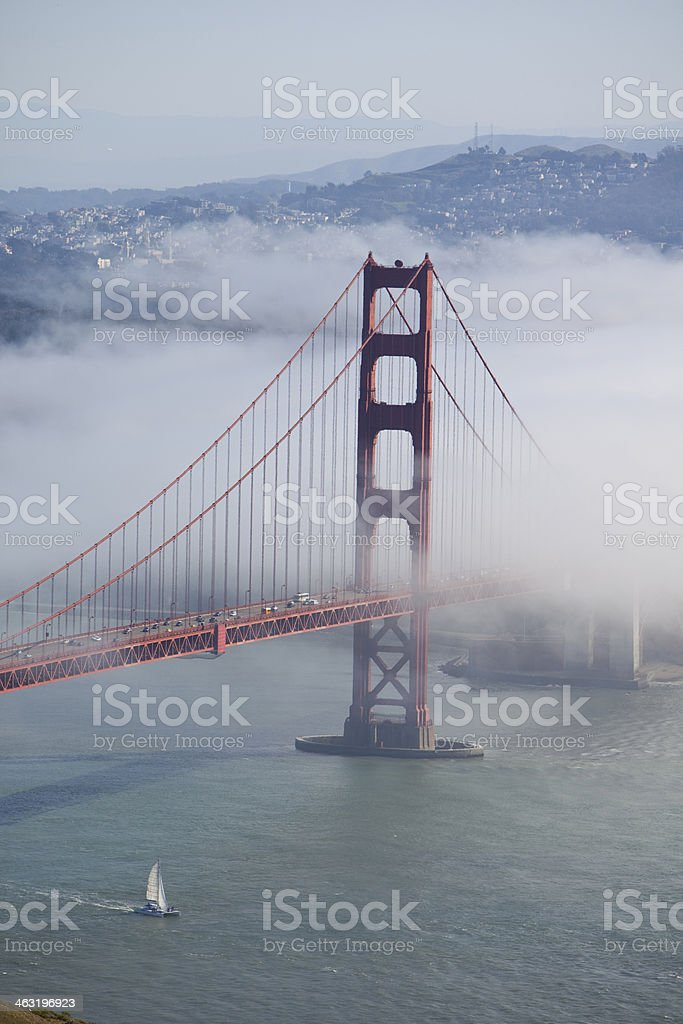 Golden Gate with fog and San Francisco in background royalty-free stock photo