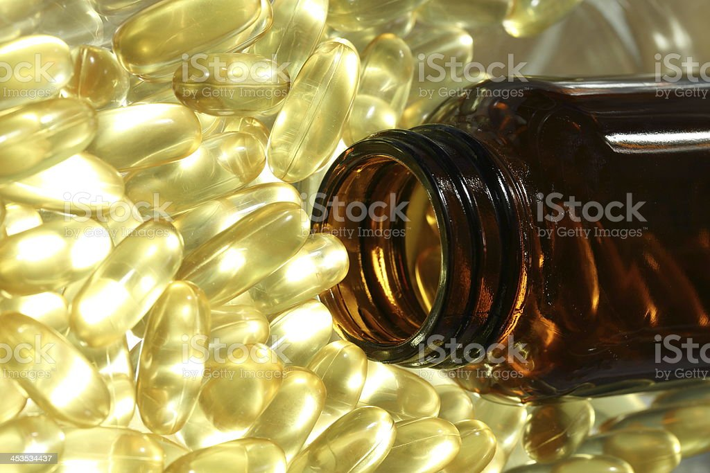 Golden gel vitamin Omega-3 fish oil capsules royalty-free stock photo