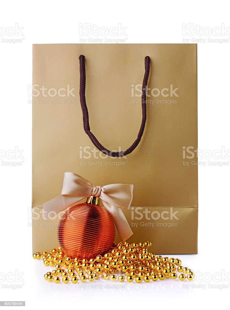 Golden gift bag and Christmas decorations stock photo