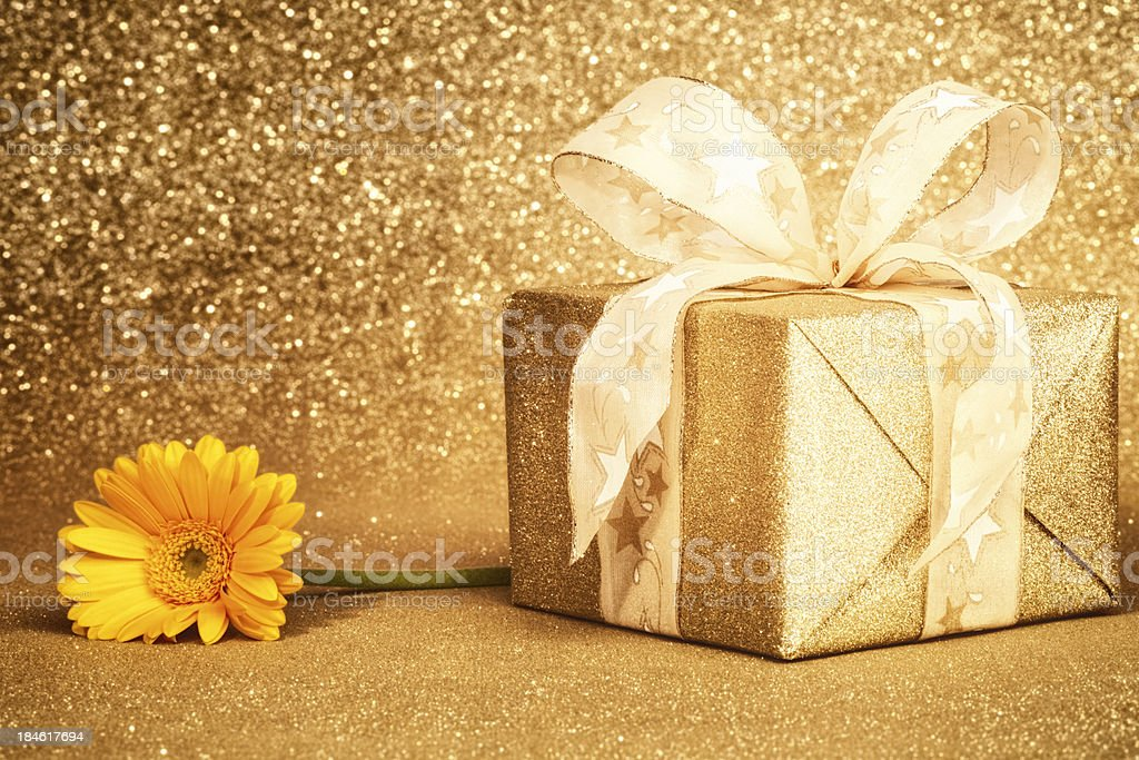 Golden Gift Box with Gerbera royalty-free stock photo
