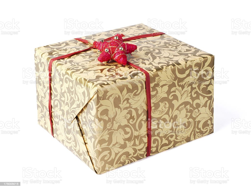 Golden gift box with red ribbon and star royalty-free stock photo