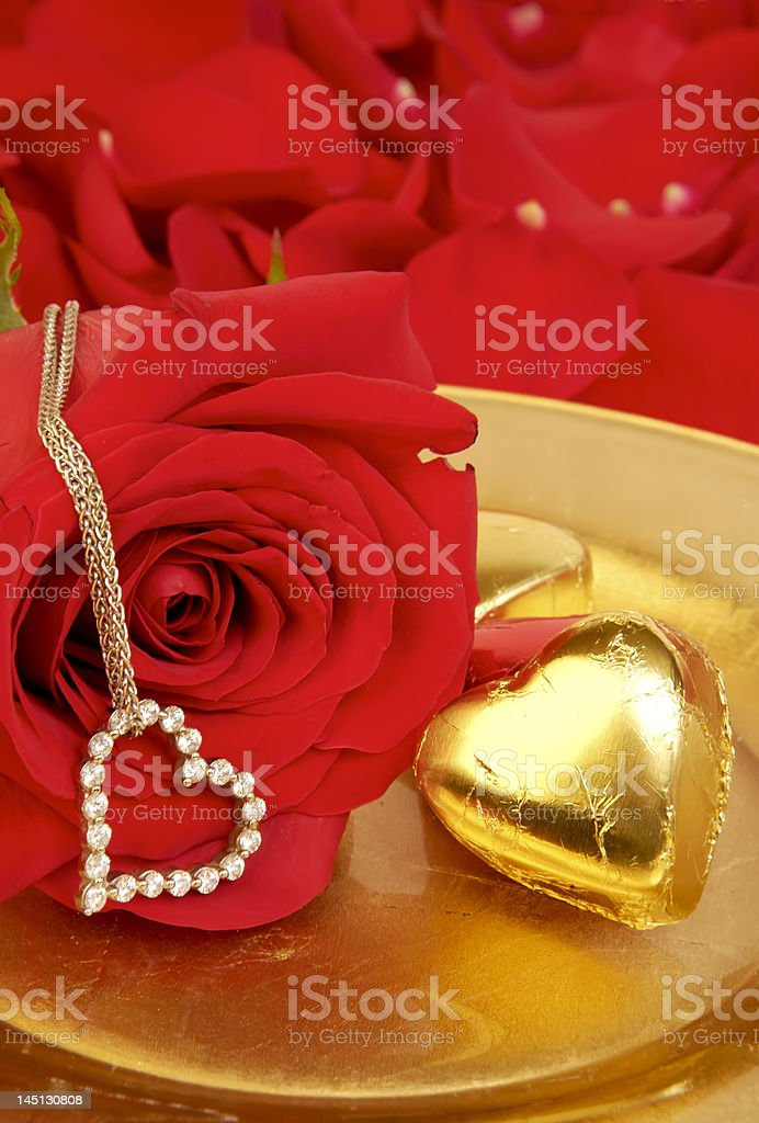 Golden Gifts and Red Roses royalty-free stock photo