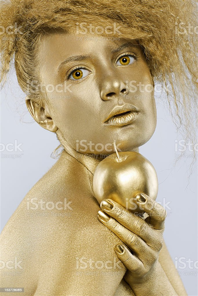 golden girl with apple royalty-free stock photo