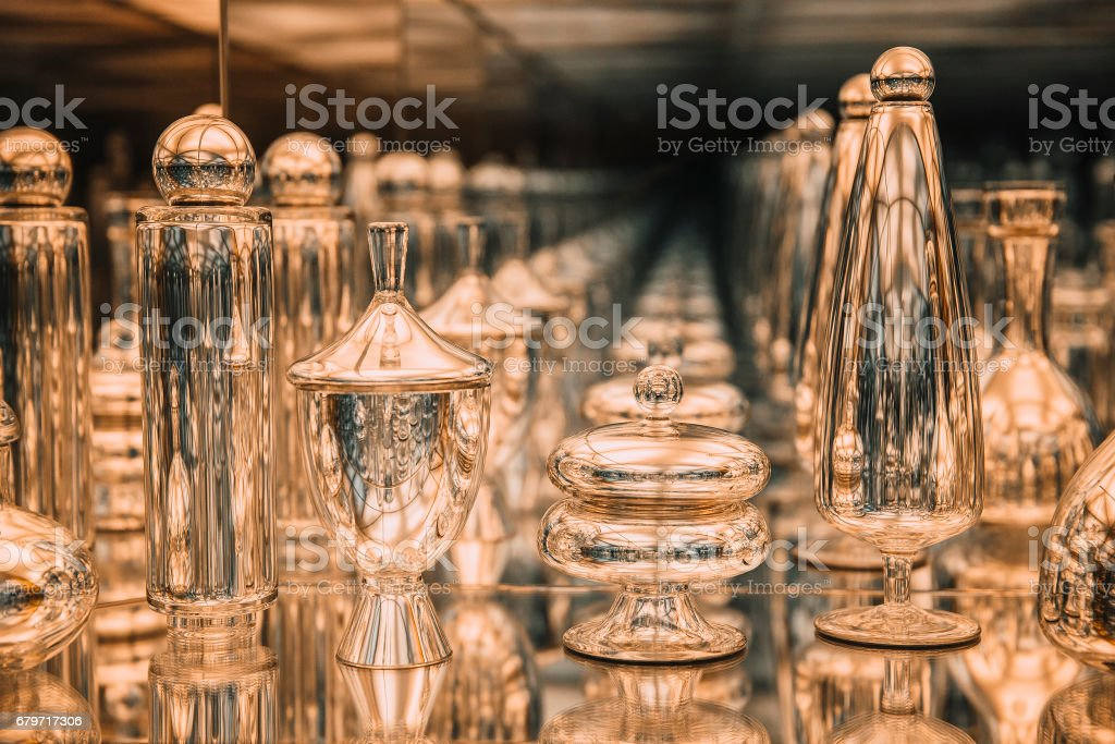 golden glass bottles reflected in the mirror stock photo