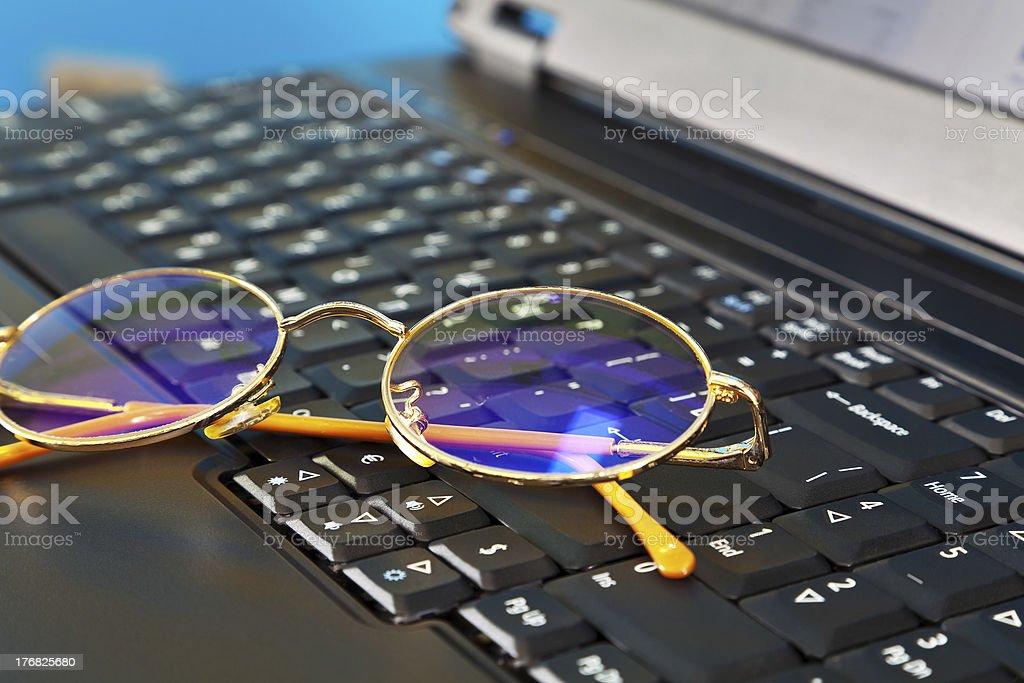 Golden glasses on laptop royalty-free stock photo