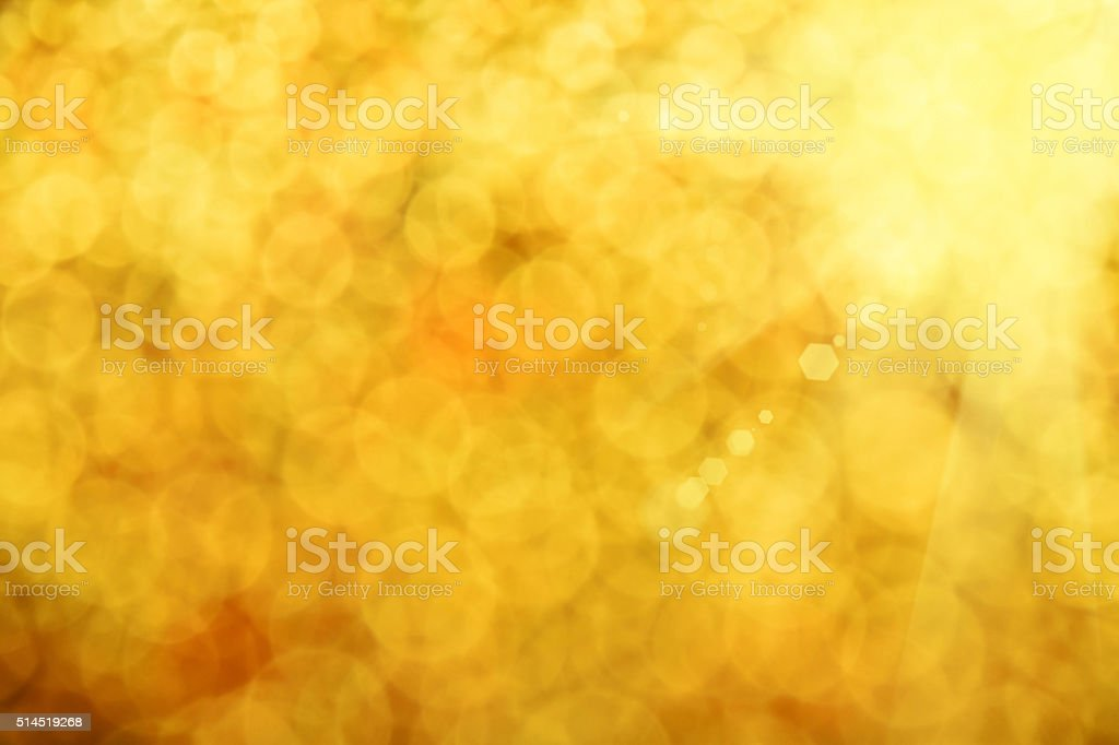 Golden glitter light summer abstract blur background royalty-free stock photo