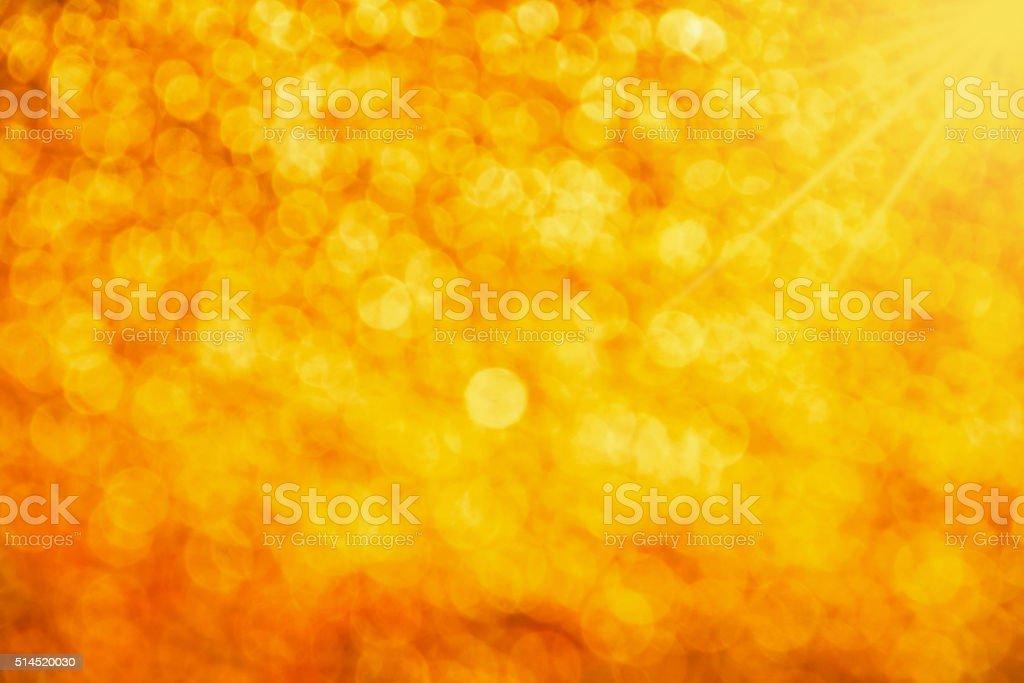 Golden glitter light summer abstract blur background royalty-free stock photo