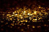 Golden glitter on black background
